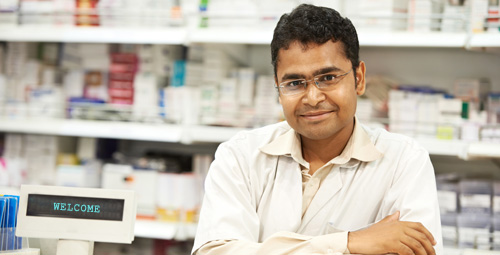 Male pharmacist smiling at camera